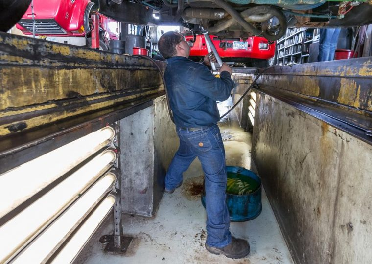 Changing oil in your semi truck for preventative maintenance - Blaine Bros